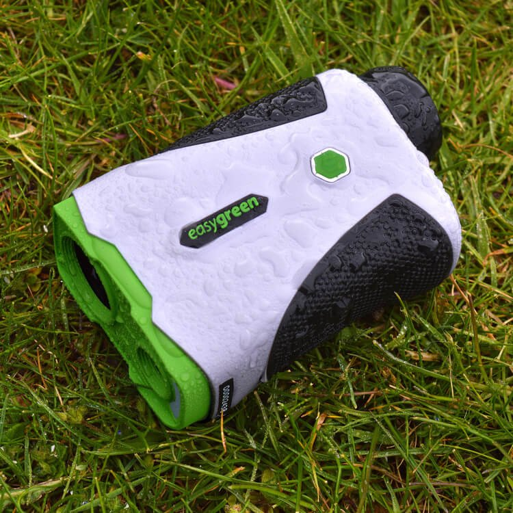 Easygreen OLED Pro Rangefinder showing it's IPX4 water resistant lying in the grass