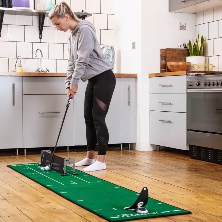 PuttOUT Alignment Sticks and Gates Female Golfer