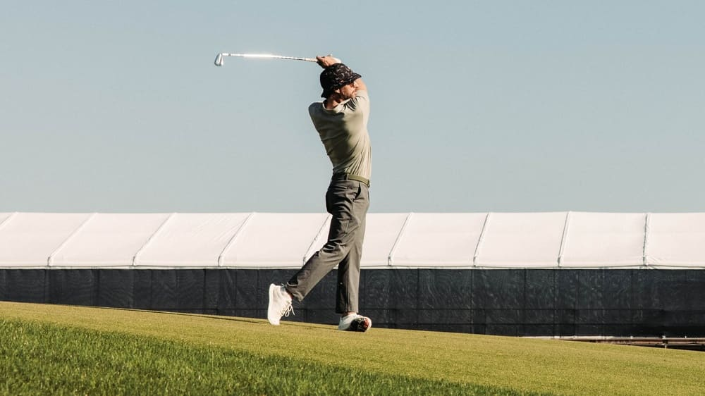 Golfer hitting from the fairway side picture